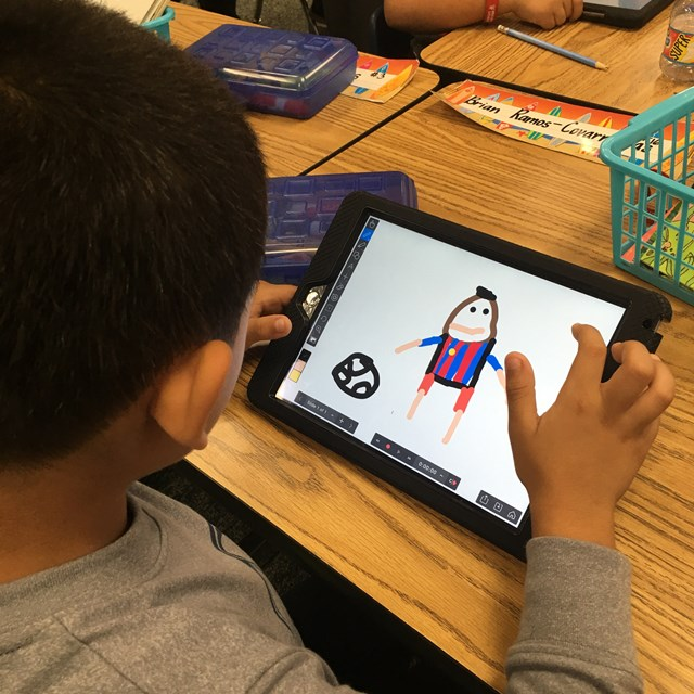 Students use tablets to draw, practice skills, learn reading and writing, and more!