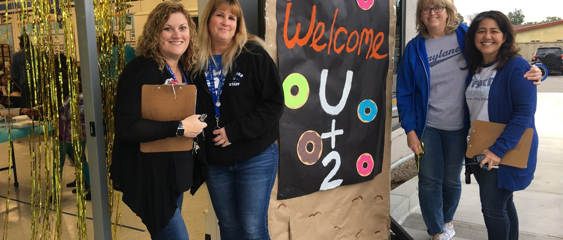 Mrs. Wilkerson, Ms. Padget, Mrs. Redmond, and Mrs. Graham getting ready to welcome students and their guests to our U + 2 Donut Party